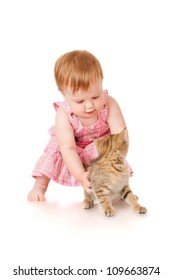 Little girl playing with kitten, isolated on white