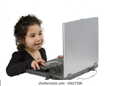 little girl playing with laptop computer