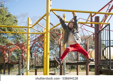 Little Girl Playing with monkey bars