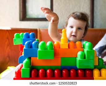 Little girl playing with multicolor blocks