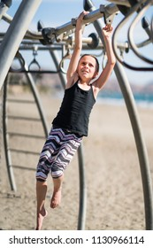 LIttle girl playing on jungle gym