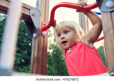 little girl playing on monkey bars, kids sport