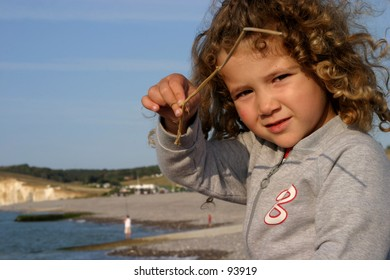 little girl playing on a North Sea beach