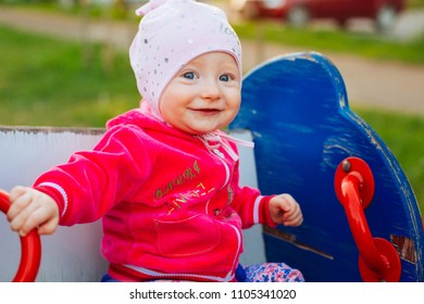 little girl is playing on the playground