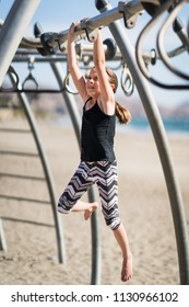 Little girl playing on playground equipment