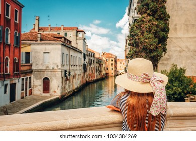 Little girl playing on the streets of Venice. Family travel with children