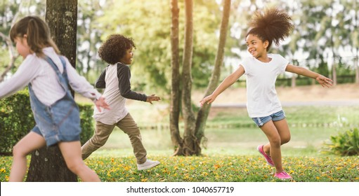 little girl playing outdoor - child kids and friend happy.