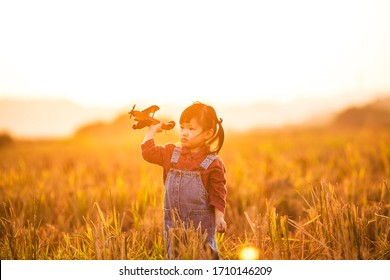 A little girl playing outdoors,  free flight concept