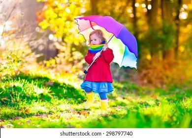 d563cb629 child holding umbrella Images