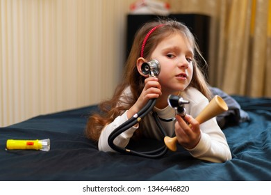 The little girl is playing in a real nurse or doctor.