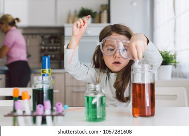 Little girl playing science in the kitchen