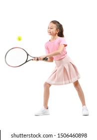 Little girl playing tennis against white background