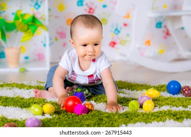 little girl playing with toy balls