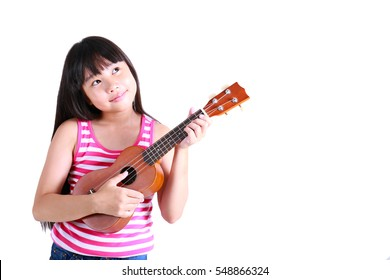 little girl playing ukulele in the studio on a white background