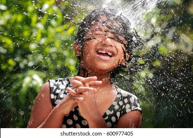 Little girl playing with water in the outdoor