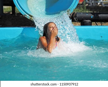 Little girl playing in a water park