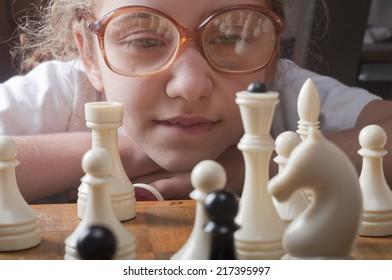 little girl plays chess