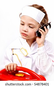 little girl plays a doctor with toy telephone