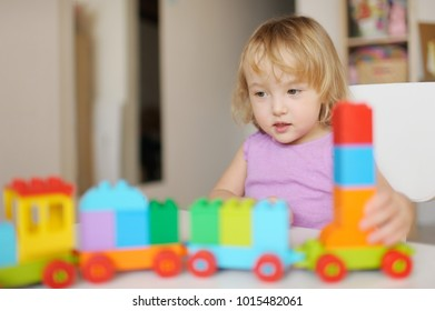 the little girl plays at home in developing games