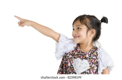 little girl pointing at something, isolated on white background