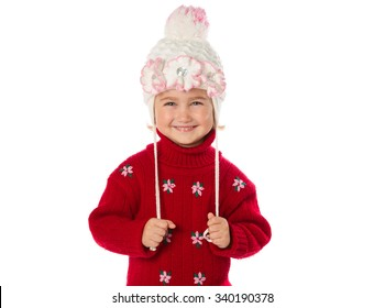 Little girl with ponytails in a warm hat and red sweater isolated on a white background