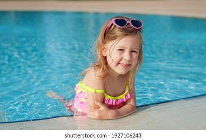 little girl in the pool. Summer vacation