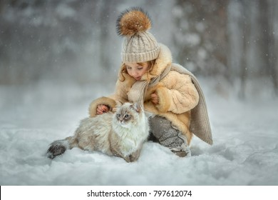Little girl portrait with cat in winter park