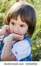 Little girl portrait on a summer field