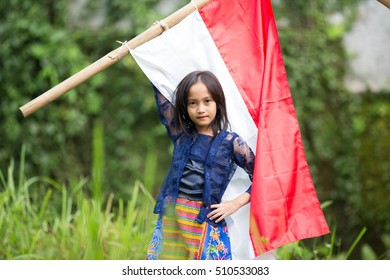 Little Girl Poses with Red-White Flag