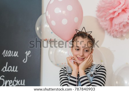 Little Girl Posing With Balloons For Her Birthday Party