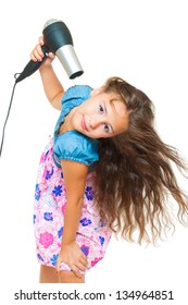 little girl posing with hair dryer isolated on white