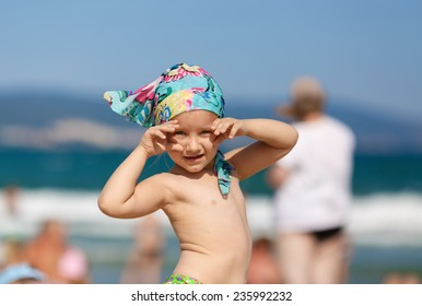 Little girl posing and looking at the camera. Shallow depth of field.