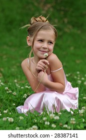 Little girl is posing on the lawn