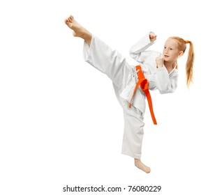 Little girl practice karate isolated on white