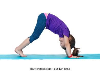 Little girl practicing  downward dog yoga pose