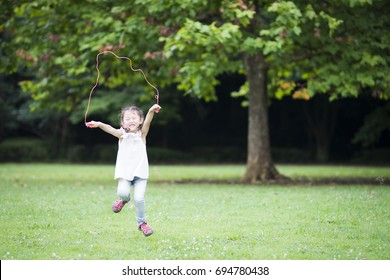 Little girl practicing jump rope