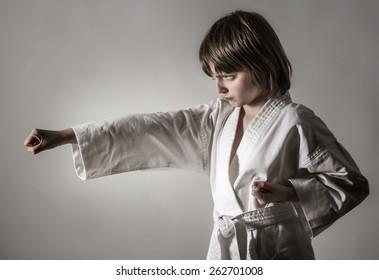 a little girl practicing karate