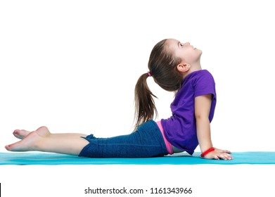 Little girl practicing upward dog yoga pose