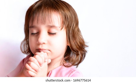 Little girl praying in the morning. Hands folded in prayer concept for faith, spirituality and religion. Pray for god blessing wishing have better life Christians together.