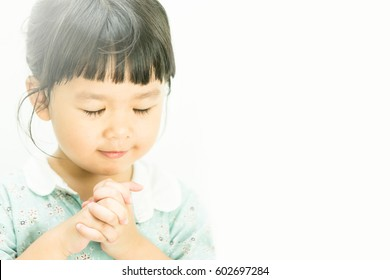 Little girl praying in the morning.Little asian girl hand praying,Hands folded in prayer concept for faith,spirituality and religion.