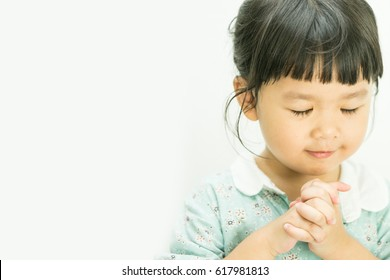 Little girl praying in the morning.Little asian girl hand praying,Hands folded in prayer concept for faith,spirituality and religion.