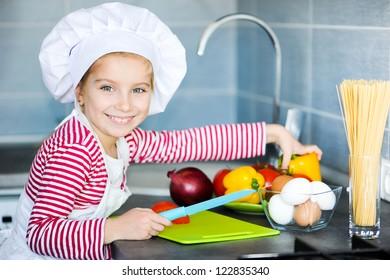Little girl preparing healthy food on kitchen