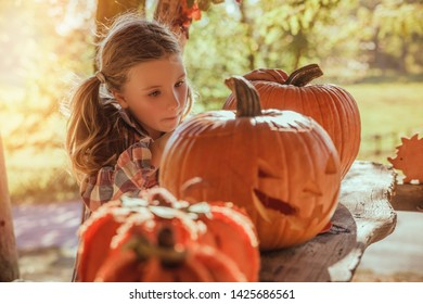 little girl preparing pumpkin for party