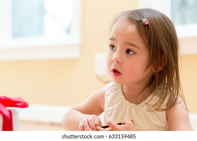 Little girl with present box at home