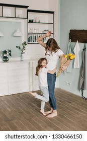 little girl present flowers to her mother