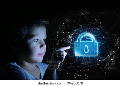 A little girl presses her finger in front of her and bright futuristic graphics appear on internet security. Concept of: future, network, technology, security for children.