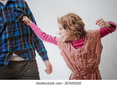 Little girl punching man in chest