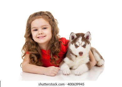 Little girl with puppy husky