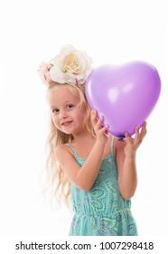 little girl with purple baloon