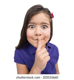 little girl putting finger to mouth. nice child making big eyes